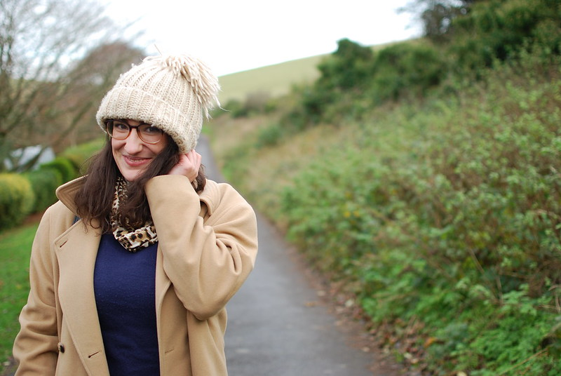 chambray and curls bobble hat and camel coat