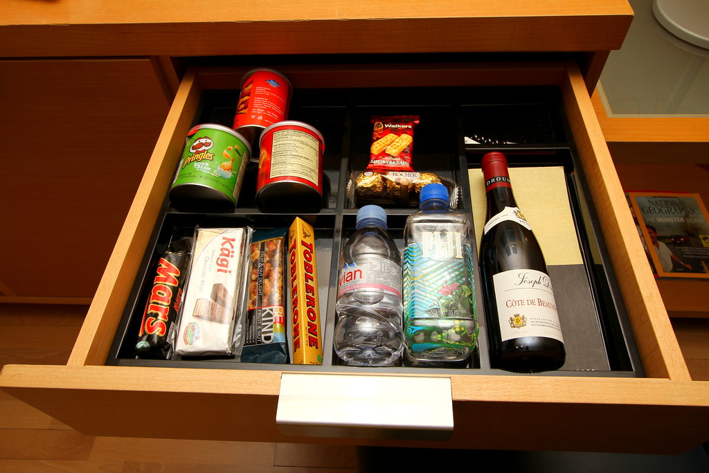 They have snacks, drinks & wine in the Grand Club Room
