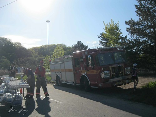 Firefighters at the water station with their fire truck.