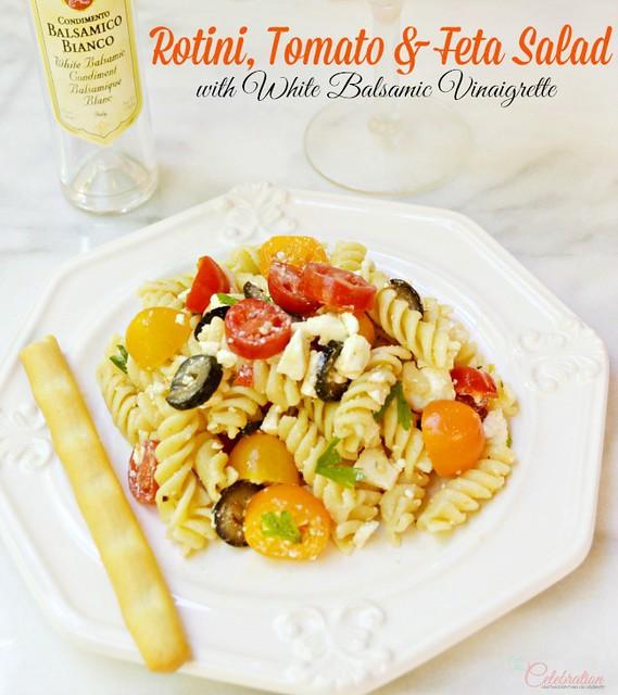 Rotini, Tomato & Feta Salad on a white plate.