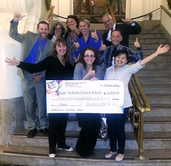Photo: Burbank folks with a big check