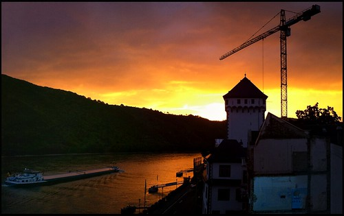 travel blue orange tower water yellow sunrise river germany landscape europe purple crane earlymorning dramatic eu historic rhine barge touring boppard iphone ipad historicplaces iphoneography snapseed pstouch