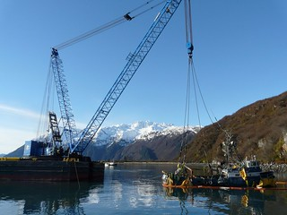 After almost three months underwater, the fishing vessel Fate Hunter was successfully lifted, refloated and towed to Cordova, Alaska, on Oct. 29, 2013. Following the grounding of the fishing vessel near Shoup Bay on Aug. 11, 2013, Alaska Marine Response and Alaska Chaudux deployed boom, removed all recoverable fuel, hydraulic and lube oils and stabilized the Fate Hunter in preparation for salvage operations to remove the vessel from the rock ledge on which it rested. (Photo courtesy of Global Diving & Salvage Inc.)