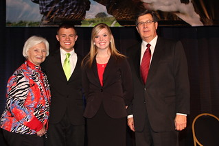 Justin Hobbs (left center) and Erica Rogers (right center) received the 2013 Outstanding Farm Bureau Youth award from Betty Farris, First Vice Chair of the KFB Women's Committee (left), and David S. Beck, KFB Executive Vice President (right)