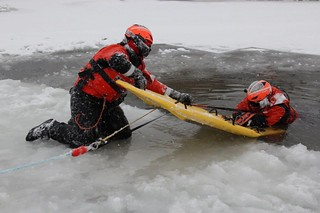 Members of Coast Guard response crews from throughout the Great Lakes region, including Air Stations Detroit and Traverse City, participate in Ice Rescue Training and a Ready For Operations Course held at Coast Guard Station Portage, Mich., which included the use of a MARSARS board, Dec. 11, 2013. Snow and subzero temperatures provided ideal conditions for the three-day training session. (Coast Guard photo by Chief Petty Officer Casey McDonald)
