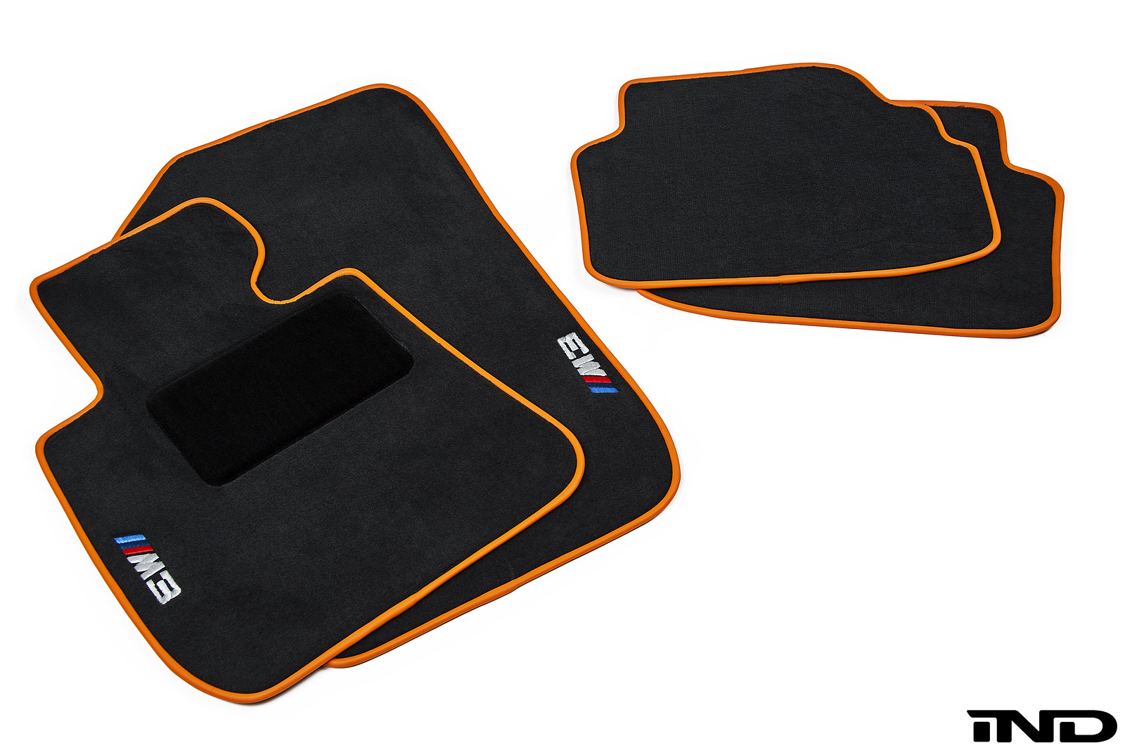 Ind starts with an original bmw floor mat and modifies the piping surrounding the edges of the mat with one of nearly one hundred custom colors to create a