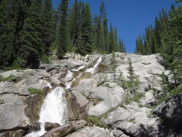 0306 Video of the Cascade River cascading down smooth granite