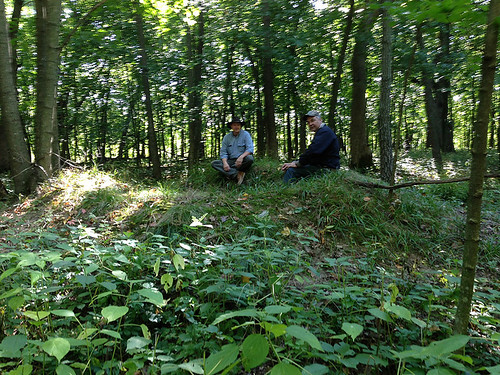 Frank Heisner and Jim Ritterbusch sit alongside the crater of the former historical mounds. NRCS photo.