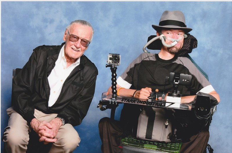Stan Lee sitting next to Daniel Baker