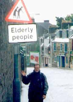 Elder Müller at an Elderly People sign