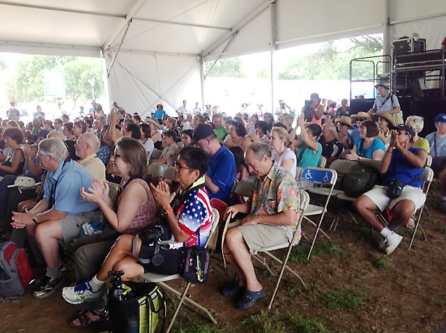 <p>The crowd shows their appreciation for the University of Hawaii performers at the Smithsonian Folklife Festival stage.</p>