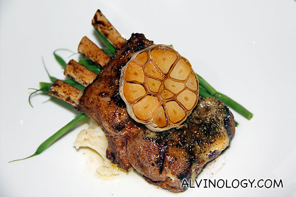 "CANTERBURY PLAINS"" Rack of Lamb (S$52) - tender lamb coated with trio of peppercorns and grilled garlic served on mashed potatoes and sautéed haricot beans"
