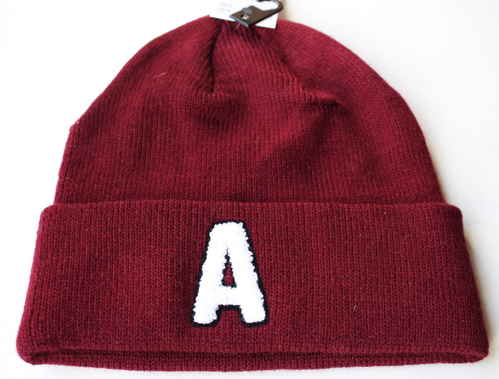 red beanie with letter A from H&M