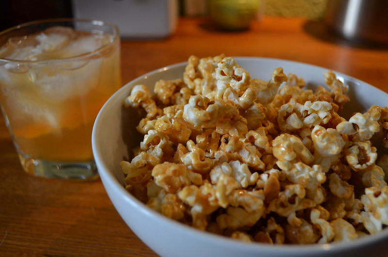 Salted caramel bourbn popcorn with peanuts served with bourbon