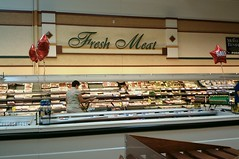 Fresh meat sign, and retro looking cooler in the aisle