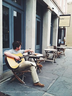 playing guitar outside bakehouse cafe