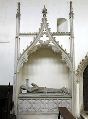 The stone effigy of Sir John de Wingfield, set in what was probably a Decorated Easter sepulchre in the chancel of the Church of St Andrew, Wingfield, Suffolk, England