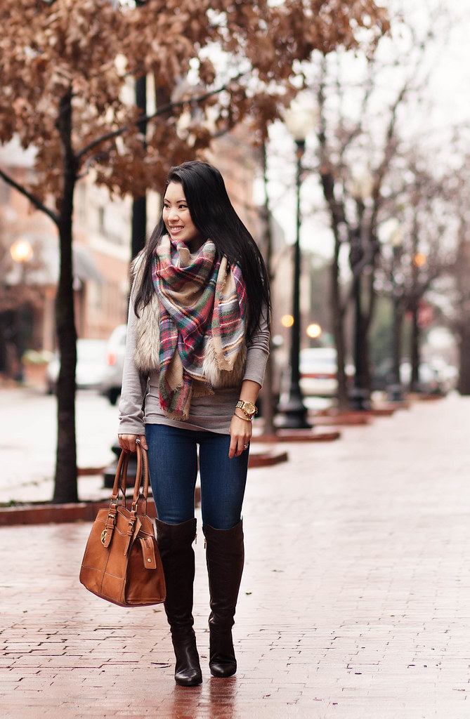 cute & little blog | plaid scarf, fur vest, skinny jeans, michael kors bromley over the knee otk boots | winter outfit layering