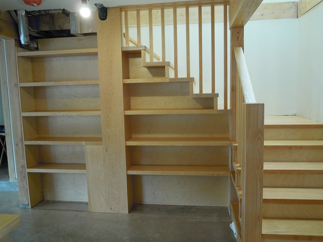 May 19 - built in book case under the stairs.