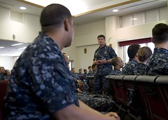 Vice Adm. Bill Moran speaks with Sailors during an all hands call in Sasebo May 19. where he addressed issues such as career sea pay, fleet manning and the career navigator program. (U.S. Navy/MC3 Justin Peeler)