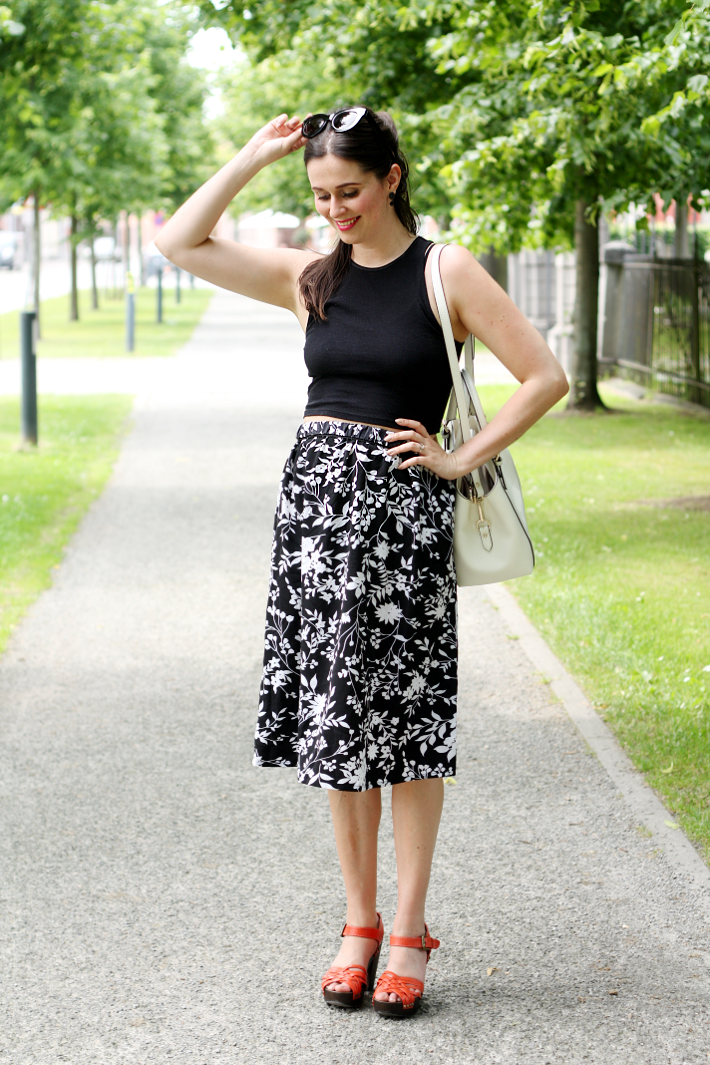 crop top midi skirt clogs cat eye sunglasses