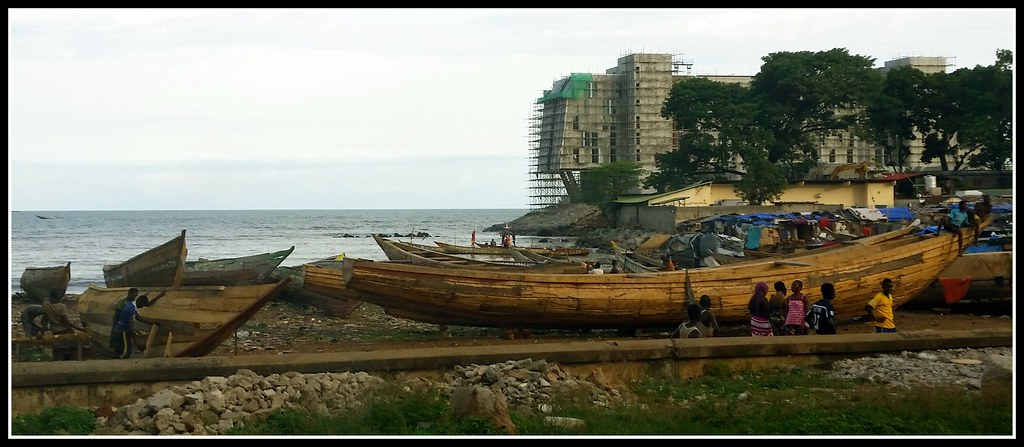 traditional boats being built on the shores of Canakry