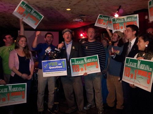 Marijuana referendum supporters celebrate.