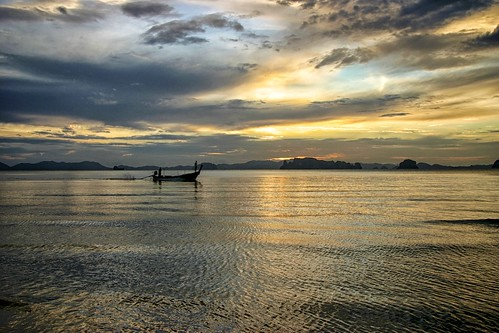 Long tail boat at sunset in Thailand
