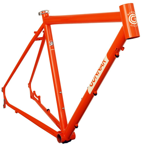 <p>Front view of Gunnar Hyper-X in Monarch Orange.  The Hyper-X, with chainstay-mounted disc brakes and light-weight tubing, is ideal for cyclocross competition, off-season training, distance riding and light touring.   Stainless steel dropouts protect the heaviest wear areas, while the handy zip-tie guides work with both hydraulic and cable actuated brakes.  This bike shows the optional 44mm head tube, allowing you to install a wide range of suspension forks.</p>