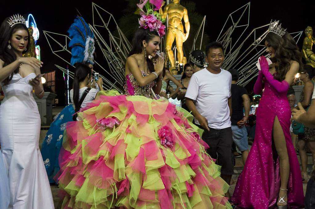 Ladyboys in colorful costumes posing with tourists at Tiffany's Cabaret in Pattaya-7