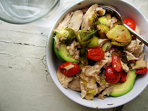 warm chicken and roasted vegetables vinaigrette over avocado