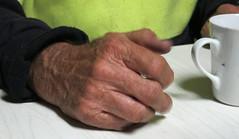 Old Timer's hand and mug