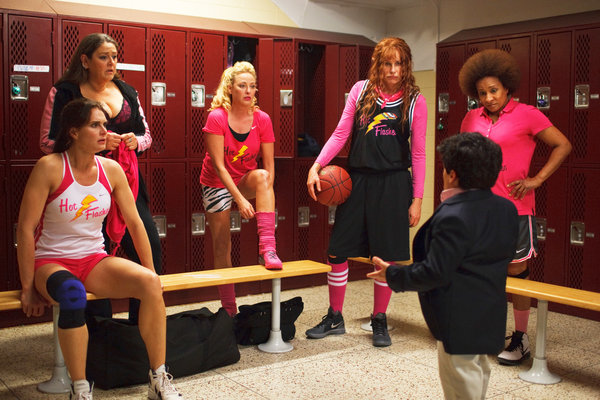 An all-female basketball team in the locker room