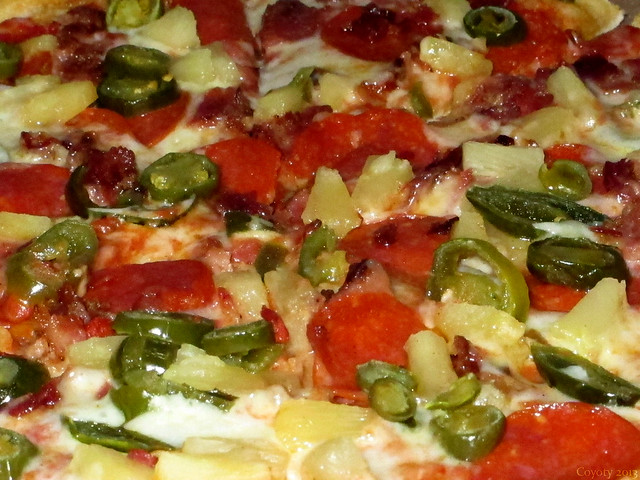 Bacon, pepperoni, pineapple, and jalapeno pizza