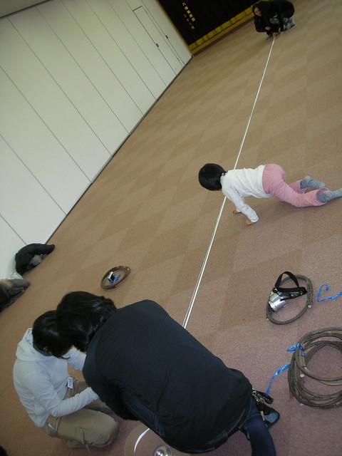 まずはロープの準備から.長さを測って着る作業.