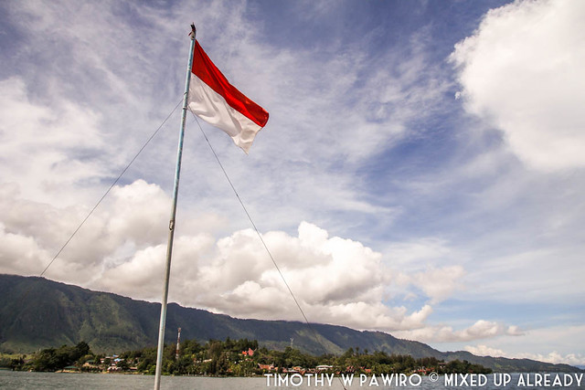 Indonesia - North Sumatra - Samosir Island - Boat ride at Lake Toba - Indonesia flag on the taxi boat