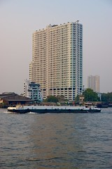 Supalai River Place Condo seen from Asiatique - The riverfront by the Chao Phraya river in Bangkok, Thailand