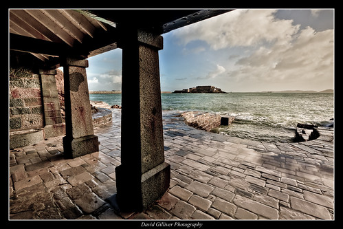 ocean sea castle history water clouds concrete harbour historic horseshoe february shelter guernsey channelislands castlecornet davidgilliver davidgilliverphotography