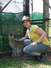 Leah petting a Serval