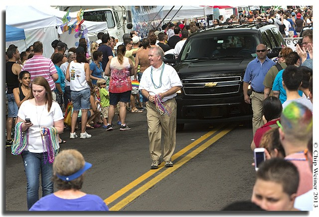 Tampa Mayor Bob Buckhorn tosses beads during his first Pride parade
