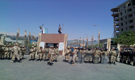 Egyptian military outside Suez Steel Company August 12, 2013. The workers have been on strike since July 23. by Pan-African News Wire File Photos