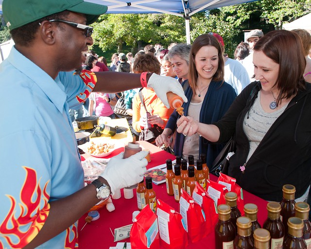 Visitors sample Guyank Sweet-Hot Pepper Sauce. Photo by Jason Gardner.