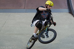 training wheels(0.0), bicycle racing(1.0), mountain bike(1.0), bicycle motocross(1.0), vehicle(1.0), bmx bike(1.0), sports(1.0), flatland bmx(1.0), sports equipment(1.0), cycle sport(1.0), extreme sport(1.0), bmx racing(1.0), stunt performer(1.0), bicycle(1.0),