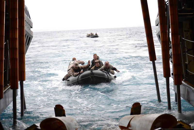 Marines assigned to the 1st Marine Special Operations Battalion from Camp Pendelton, prepare to arrive aboard USS Fort Worth