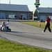 Mark Dismore Jr. takes the checkered flag to win the 2013 RoboPong 200 at New Castle Motorsports Park