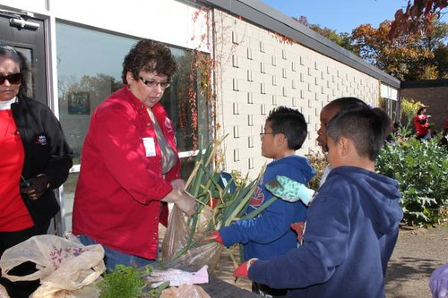 Extension horticulture educator Donna Alese Cooke prepares students for weighing their produce. Mrs. Lent's class made a delicious soup with the harvest.