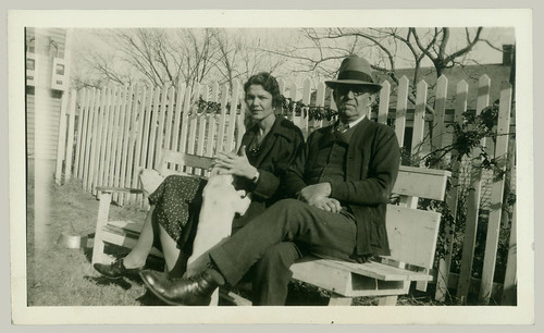 Couple on bench with dog