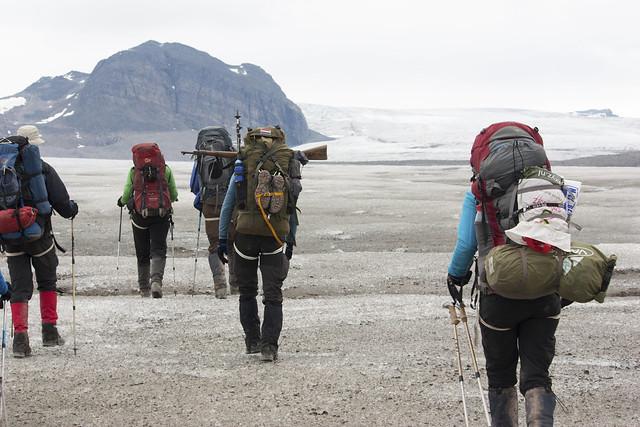 Hikers walking on a glacier