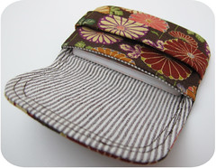clothing(0.0), sun hat(0.0), hat(0.0), cap(0.0), design(0.0), baseball cap(0.0), headgear(0.0), coin purse(1.0), maroon(1.0),