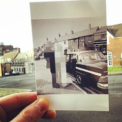 1973: Top of Mill Street. A wedding is going on, but the real focus is the buildings at the behind the couple. As pointed in previous shots, whilst buildings near The Gate and town centre were abandoned, whilst these buildings survived. The history of the